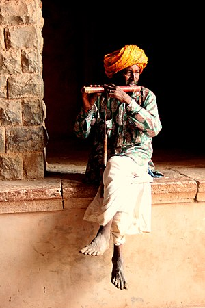 Bhilala - The man playing the flute belongs to the Bhilala tribe of Madhya Pradesh