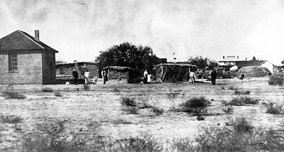 Pima dwellings of traditional and brick construction in 1900 Pima Indian dwellings 1900.jpg
