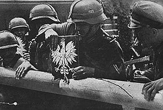 Battle of the Border - Soldiers of the German Wehrmacht tearing down the border crossing into Poland, 1 September 1939