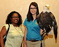Posing for picture with Bald Eagle. (10597006325).jpg