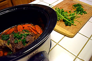 Pot roast - Pot roast with carrots and fresh parsley in a slow cooker