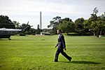 President Barack Obama walks across the South Lawn of the White House to Marine One after a statement to the media about the release of two journalists from North Korea.jpg