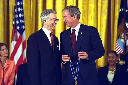 U.S. cultural figure Fred Rogers (pictured, on the left, with President George W. Bush on the right) based his television career on his sense of strident idealism. President George W. Bush Presents the Presidential Medal of Freedom Award to Fred Rogers.jpg