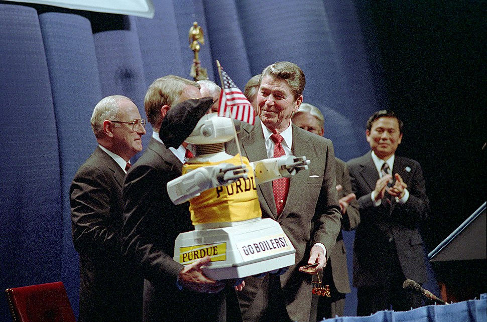 President Ronald Reagan During a Trip to West Lafayette Indiana and Purdue University and Looking at a Robot
