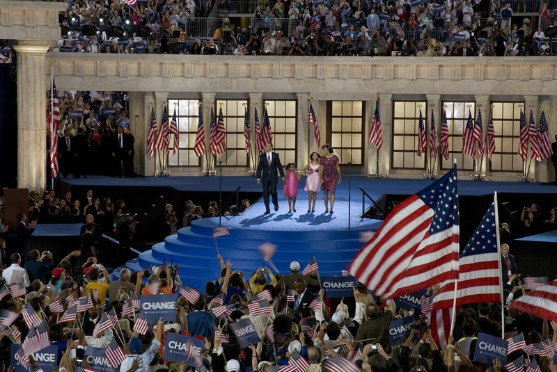 Presidential candidate Barack Obama, his wife Michelle, and his children Malia and Sasha wave to the audience at the Democratic National Convention, Denver, Colorado, August 25-28, 2008 LCCN2010719320