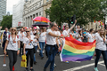 Pride in London 2016 - Staff and associates of PWC in the parade.png