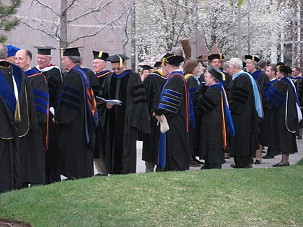 American Academic doctors gather before the commencement exercises at Brigham Young University (April 2008). The American code for academic dress identifies academic doctors with 3 bands of velvet on the sleeve of the doctoral gown. Professors.JPG