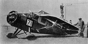 RWD 9 - An RWD 9 during the wing folding contest at the 1934 Challenge.