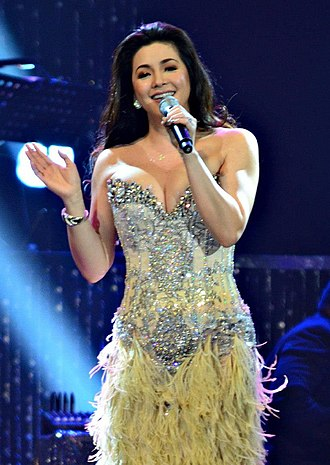 Regine Velasquez - Velasquez performing live at the Mall of Asia Arena in January 2013