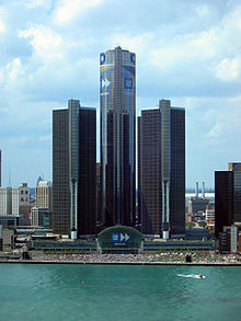 Renaissance Center With A Large Crowd Along The Detroit