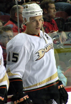 "Side profile of Getzlaf as he participates in a pre-game warmup.  He's in full uniform, including an ""A"" patch denoting his role as an alternate captain."