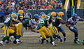 Ryan Grant (25) hits the line.jpg