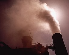 STEAM EMISSION AT THIS ASPHALT BATCH PLANT CONSISTS OF 85 PERCENT SAND DUST, ACCORDING TO THE AIR - NARA - 542544.jpg