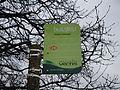 Sandown Station Approach bus stop flag in February 2012.JPG