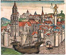 Illustration représentant Paris au XVesiècle. Diverses édifices religieux peuvent être aperçus, ainsi que des remparts au bord de la Seine sur laquelle se trouve une caravelle.