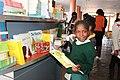 School girl going through textbooks, Namibia (39590282232).jpg