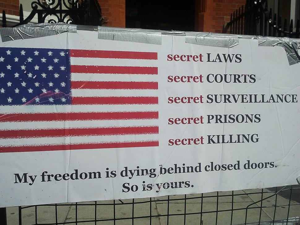 Secret Laws,placard in front of Ecuador embassy