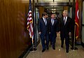 Secretary of Defense Chuck Hagel walks with Turkish Minister of National Defense Ismet Yilmaz and Minister of Foreign Affairs Ahmet Davutoglu after a meeting at the Pentagon.jpg