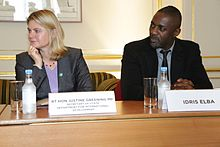 Elba and British cabinet minister Justine Greening at a meeting with diaspora representatives at the 'Defeating Ebola in Sierra Leone' conference in London, October 2014