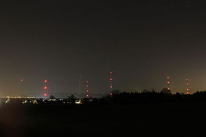 DCF77 - The low frequency T-aerial antennas of the continuously  operated DCF77 signal in Mainflingen at night