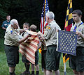 Senior Leaders of Boy Scout Troop 755 from Gambrills, Md., prepare a tattered flag for a proper retirement during a ceremony in Gambrills, Md., June 14, 2013 130614-D-MN166-659.jpg