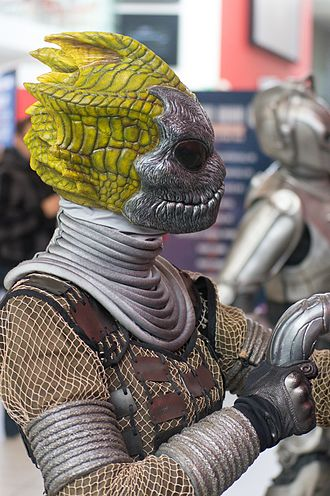 Silurian (Doctor Who) - Silurians, with their masks on, on display at an exhibition.