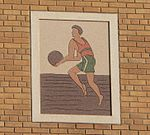 Terra cotta image of a basketball player