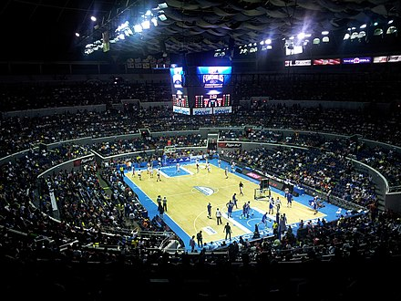 A PBA basketball game at the Smart Araneta Coliseum, Southeast Asia's largest arena. - Philippines