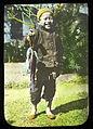 Smiling child holding fish, China, ca. 1918-1938 (MFB-LS0232).jpg