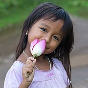 Smiling girl holding a lotus flower.jpg