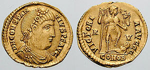 Constantius III - Constantius on a solidus. The reverse shows Constantius as a general, holding Victory in one hand and a captive enemy in the other.