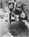 Some of the bodies being removed by German civilians for decent burial at Gusen Concentration Camp, Muhlhausen, near... - NARA - 531275.tif