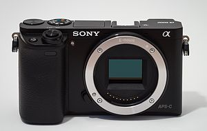 Sony α6000 - Image: Sony Alpha ILCE 6000 APS C frame camera no body cap Crop