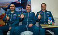 Soyuz TMA-06M crew members sit together at the Kustanay Airport.jpg