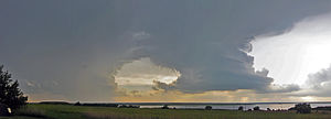 Accessory cloud - Wall cloud on the right under a cumulonimbus cloud