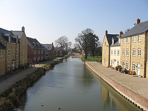 Stroudwater Navigation - The restored canal to the west of Ebley Mill is flanked by a new housing development.