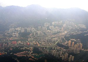 Tai Wai - Aerial view of Tai Wai, looking south. The mountains at the back mark the limit between the New Territories and New Kowloon, which is located beyond.