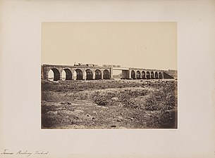 Train on a stone bridge with girder