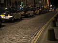 Taxis on the High Street to 'evacuate' revelers from the city.jpg