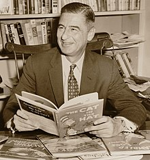 Ted Geisel holding the Cat in the Hat at Desk in 1957