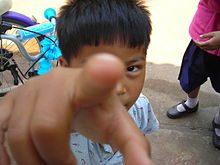 Thai boy pointing to the viewer.JPG