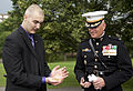 The Commanding Officer of Marine Barracks Washington, Col. Christian G. Cabaniss, right, speaks with honorary Marine Daran Wankum following a wreath laying ceremony at the Marine Corps War Memorial in Arlington 130613-M-KS211-030.jpg