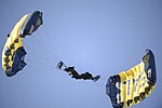 The Navy Leap Frogs make a parachute during the Army-Navy Game.jpg