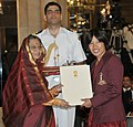 The President, Smt. Pratibha Devisingh Patil presenting the Arjuna Award for the year-2011 to Ms. Wangkhem Sandhyarani Devi for Wushu, in a glittering ceremony, at Rashtrapati Bhavan, in New Delhi on August 29, 2011.jpg