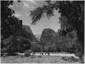 The Temple of Sinawava. Mr. Arthur Newton Pack and part of Nature Magazine staff in foreground. - NARA - 520350.tif