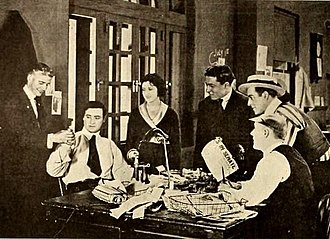 The Woman Under Cover - Still from a film magazine