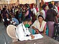 The doctors examine patients during free health camp as part of the Bharat Nirman Public Information campaign, in Tamenglong district of Manipur on May 18, 2011.jpg