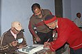 The voter signing in the polling register to register his name at Chetram Sah Tulgharia Inter College polling booth during the 5th and final phase of General Election-2009, in Nainital, Uttarakhand on May 13, 2009.jpg