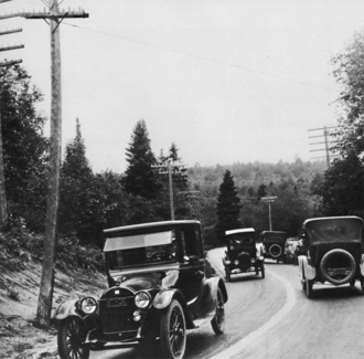 Michigan Department of Transportation - Dead Man's Curve along the Marquette–Negaunee Road shown in 1917 with its hand-painted centerline, the first in the nation