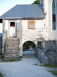 The back of the Catholic Church on Nukunonu in Tokelau. The arch goes over the main street of the village. Tokelau Nukuono Church 20070716.jpg
